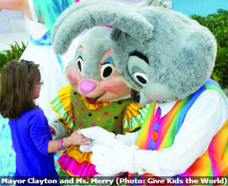 Mayor Clayton and Ms. Merry, rabbits from Give Kids the World Village