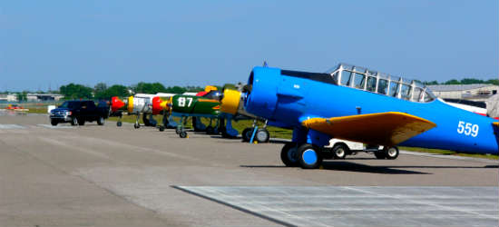 Restored warbirds sit on the flight line. Photo: Kirk Garreans