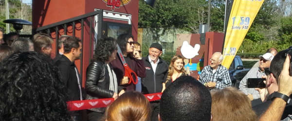 Paul Stanley and Gene Simmons about to cut the ribbon to open Rock & Brews Oviedo