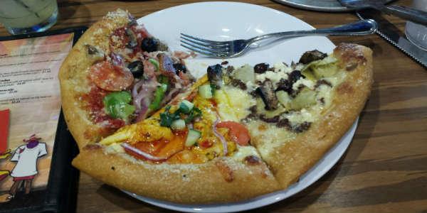 Mellow Mushroom - House Special pizza, Thai Dye pizza, Philospher's Pie pizza