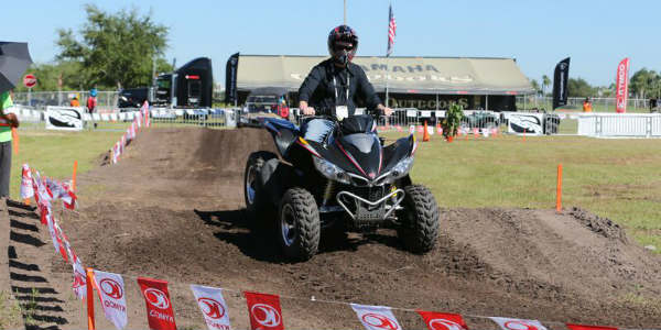 AIMExpo - man on ATV