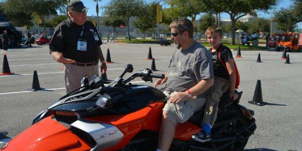 AIMExpo 2015 - family on motorcycle