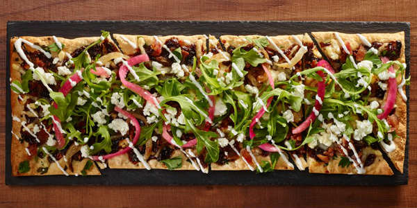 The Glass Knife in Winter Park is adding two Flatbreads to their menu. The Mediterranean Flatbread (pictured above) features sweet fig butter, goat cheese, Neuske's bacon and caramelized onions topped with arugula, Gruyere cheese and is finished with a lemon white balsamic drizzle and lemon crème fraiche.