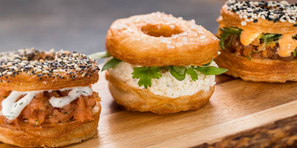 Trio of Savory Croissant Doughnuts — $9.50, DDP Snack Credit Eligible. Whipped Herb Cream Cheese with Sea Salt (V); Chicken Mousse with Fresh Herbs and Everything Bagel Seasoning; Spicy Tuna with Sriracha Mayonnaise and Sesame Seeds.