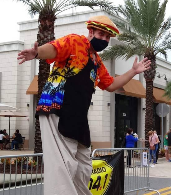 Sunset Walk at Margaritaville Resort Orlando - stilt walker