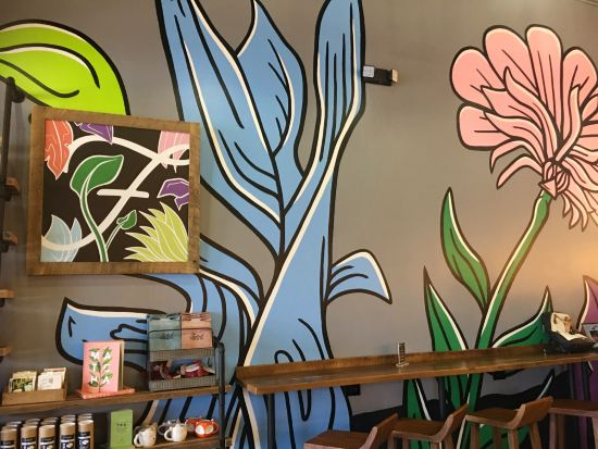 A flower mural at Foxtail Coffee's new Winter Park location